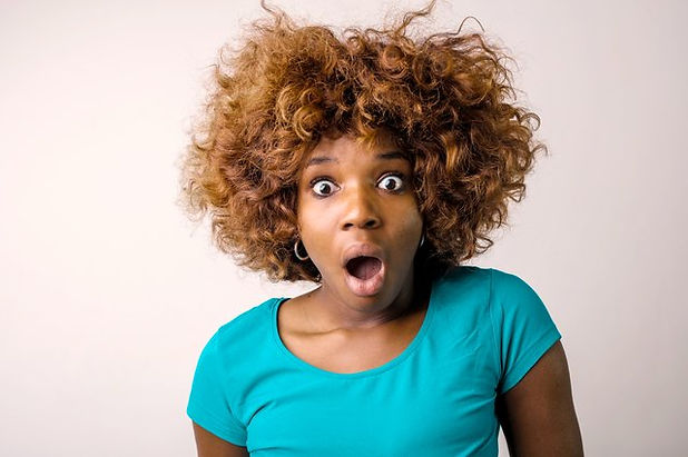 portrait-photo-of-shocked-woman-in-blue-