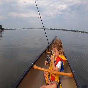 Little boy first catch fish
