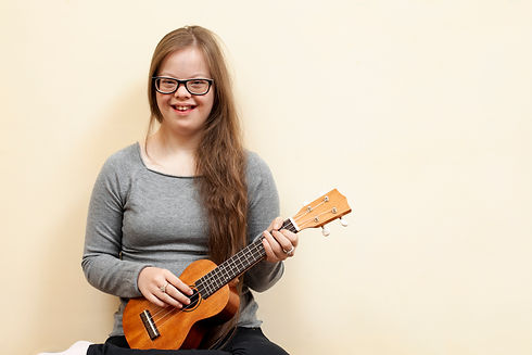 smiley-girl-with-down-syndrome-holding-g