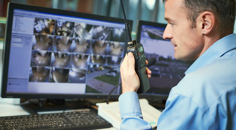 Security worker with radios.jpg Video surveillance system.jpg