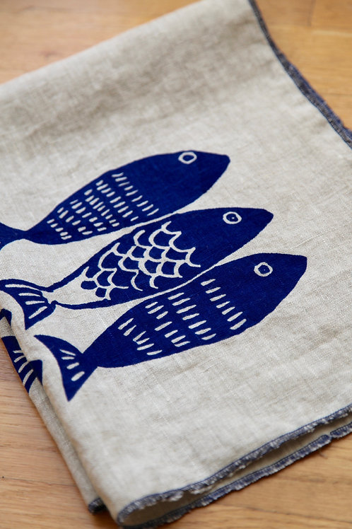blue fish on natural linen