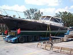 Boat on a Trailer, ARI shipping corporation, shipping corporation, heavy machinery shipping, warehousing, fulfillment, harzardos cargo, refridgerated cargo, oversized cargo, cargo, materia handling, shipping, boat transport