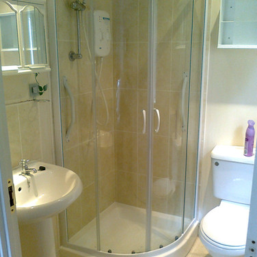 Full bathroom refit with wall and floor tiling