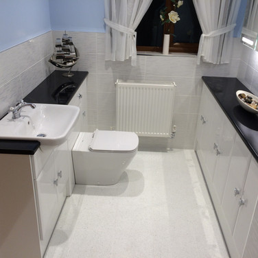 Bathroom refit with wall and stone floor tiling