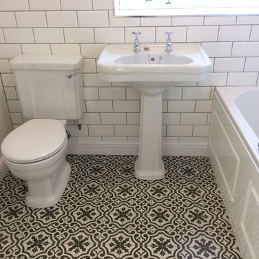 Bathroom refit with wall and designer floor tiling