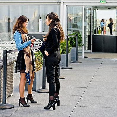 Two women talking in a rooftop terrace in Paris RSM_5302v1