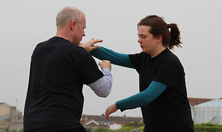 Simon and Carline practicing 5 Section San Shou