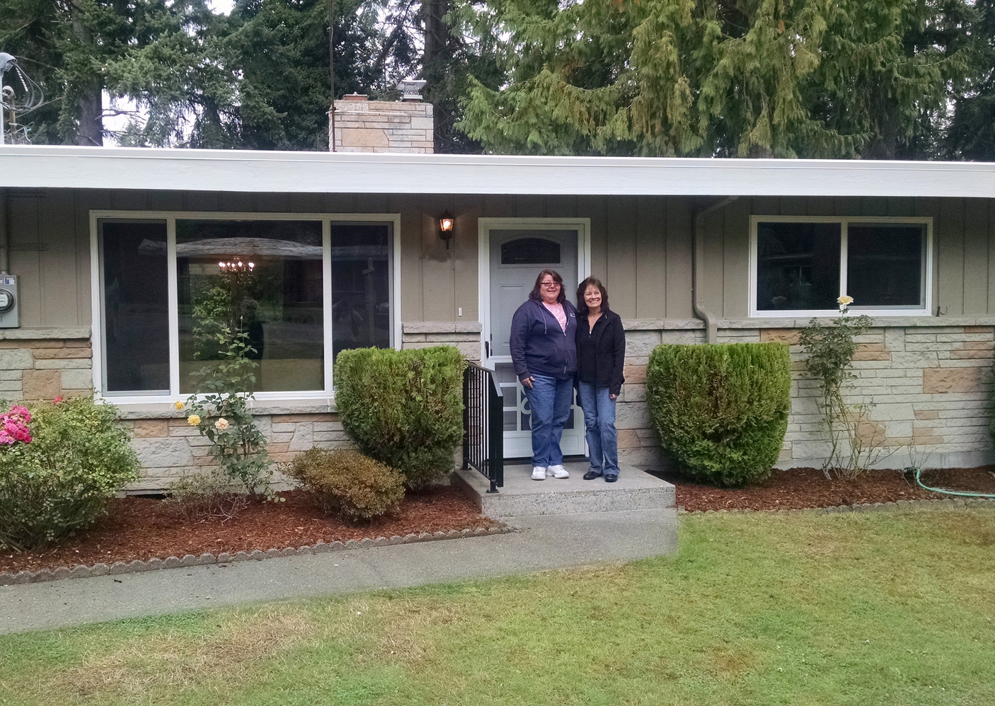 2014 ~ Family of SASH Clients Celebrating the Home Sale