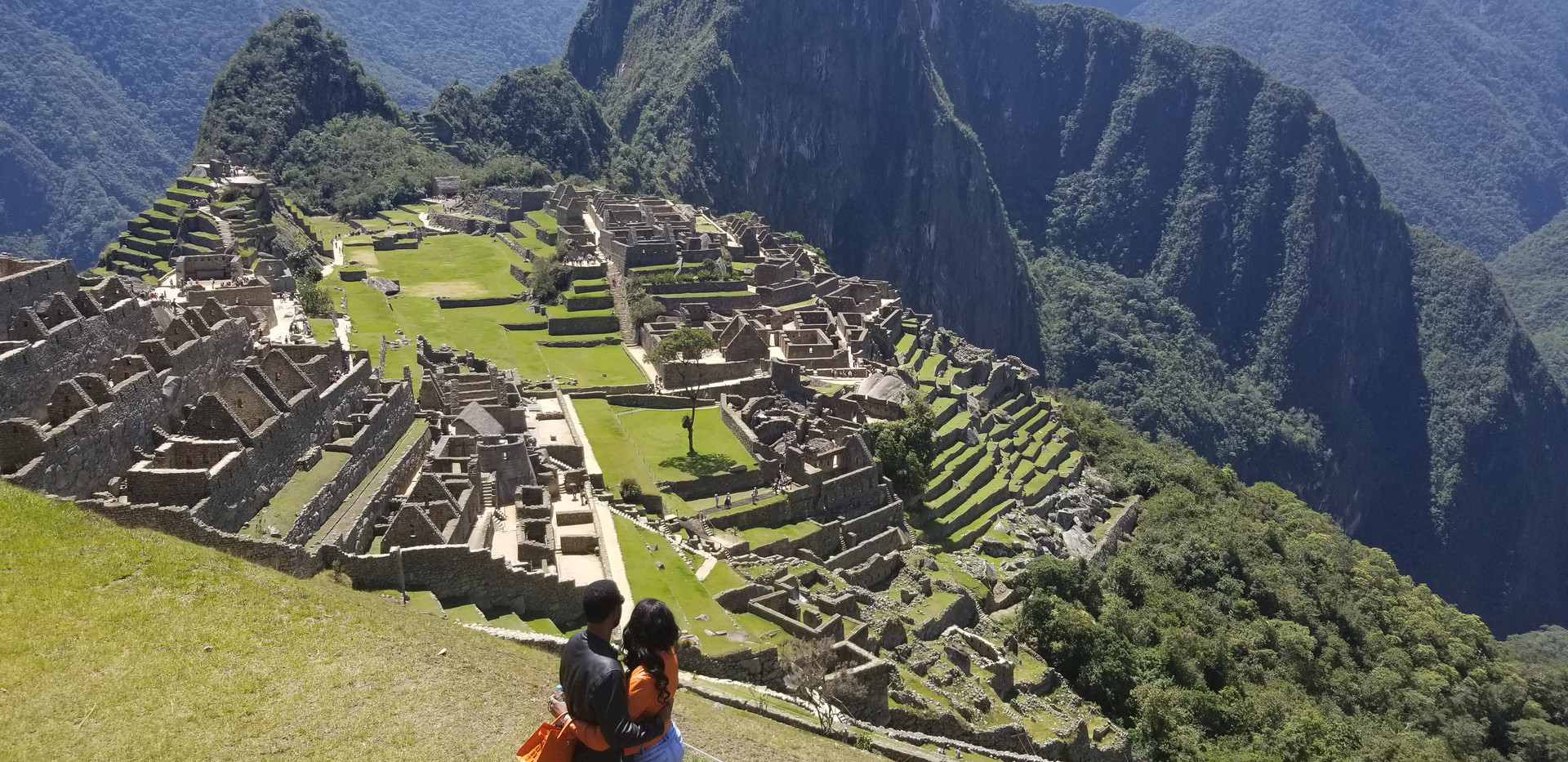 Standing at the top of Machu Picchu