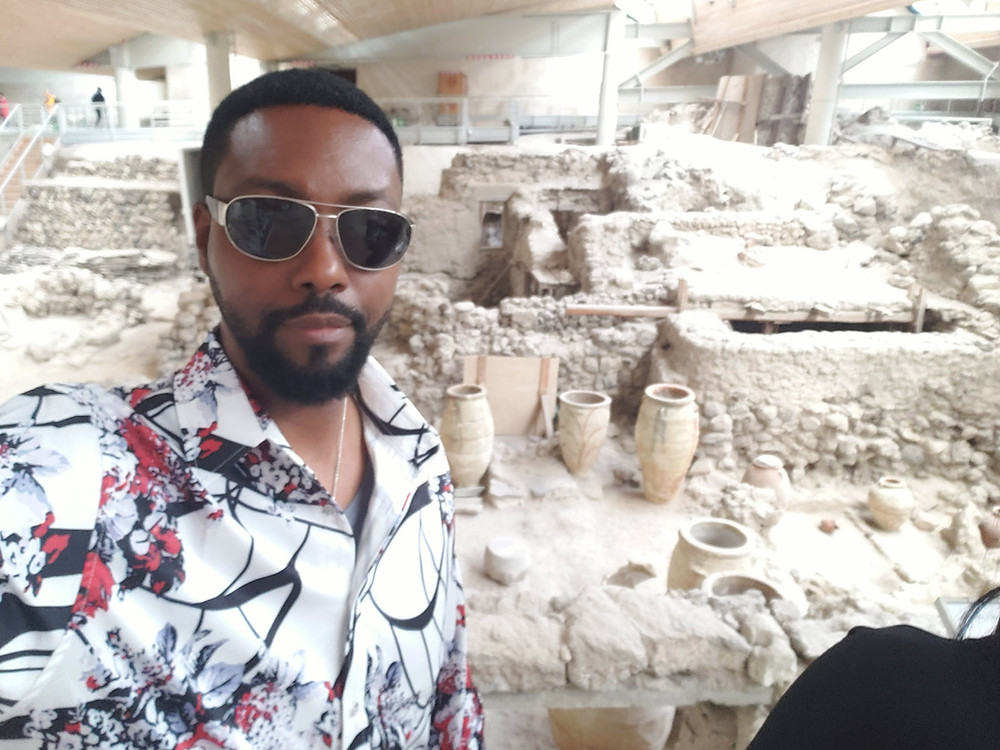 Billy Carson at the excavations in Akrotiri on the island of Santorini in Greece