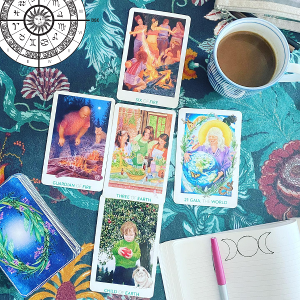 Astrology chart, Gaian tarot cards, in a new moon moonthly spread, moon phases and coffee, journal and pen to calm worry, anxiety and to cultivate clarity and direction.