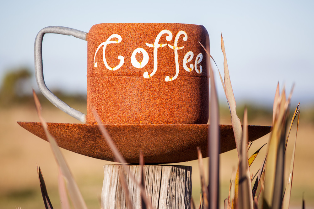 Gigantic coffee cup on post