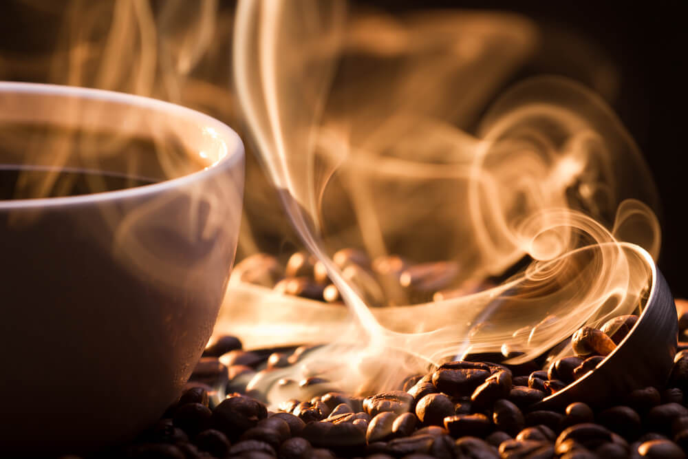 coffee cup, coffee beans and swirl of steam