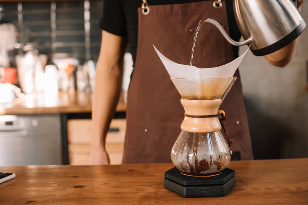 Hot water pouring over Chemex coffeemaker