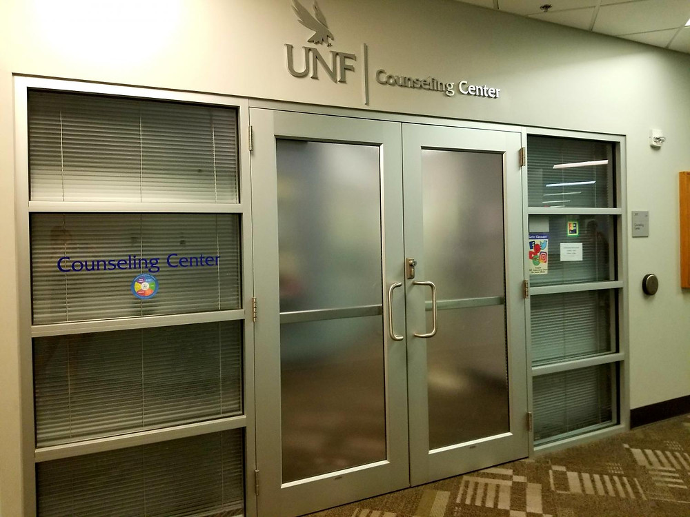 closed double silver doors are shown under a sign reading UNF counseling center