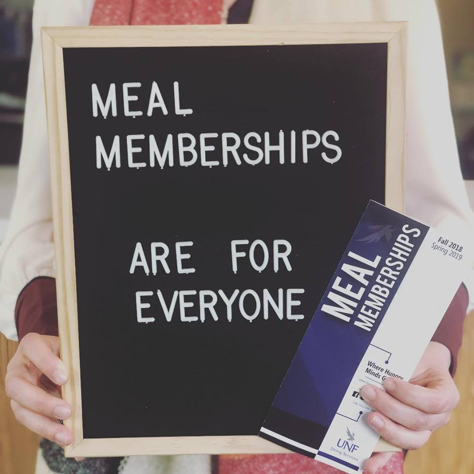 """A writing board that says """"Meal memberships are for everyone"""""""