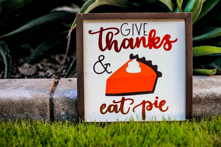 """a sign reads """"give thanks and eat pie"""""""