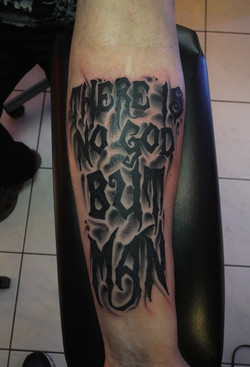 Dark Lettering Tattoo