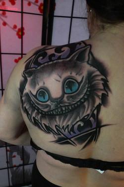 Grinsekatze Tattoo