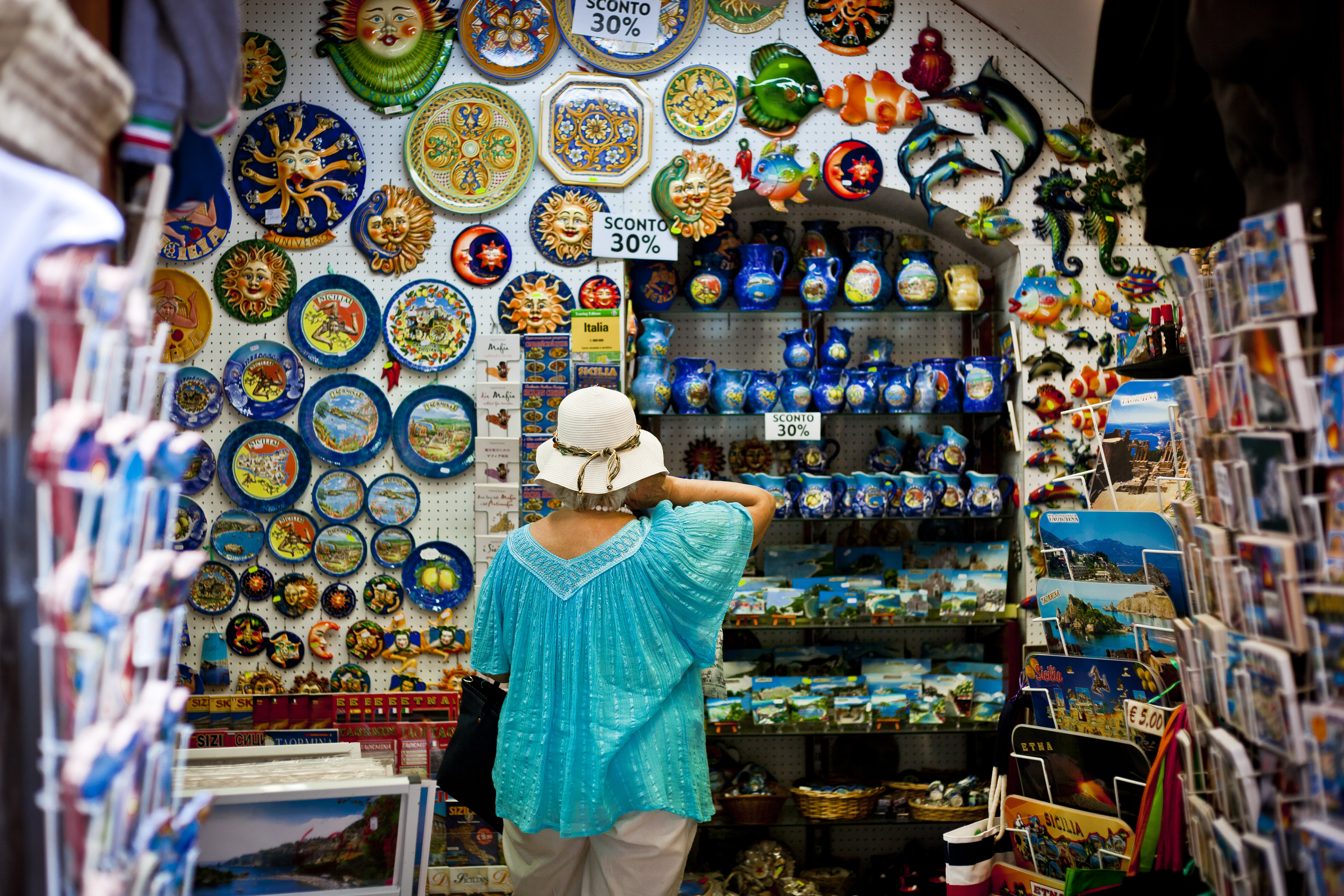 A Woman in front of Plates