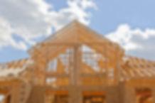 Your dream home.jpg New residential construction house framing against a blue sky.jpg