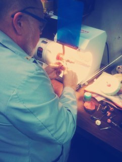 Mr. Adkins working on repolishing a patient's prosthesis.