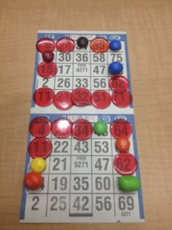 Trying not to eat my M&M chips during a serious match of border Bingo!