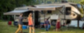 Friends playing Laddeball outside Keystone Cougar Fifth Wheel RV