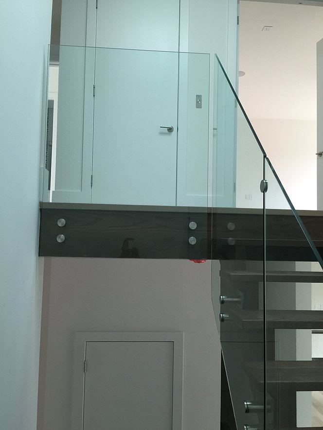 GLASS RAILING WITH STANDOFF SYSTEMS