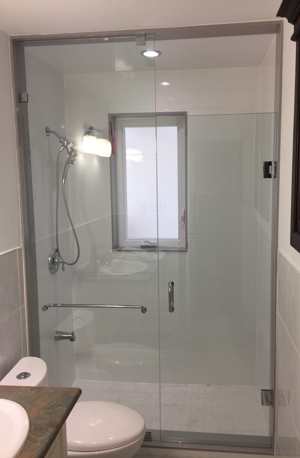 TYPICAL GLASS SHOWER ENCLOSURE