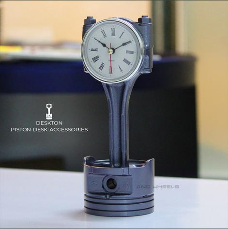 Piston desk clock