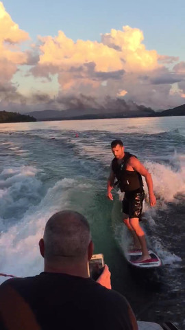 Kyle and Brad Surfing behind a Tige