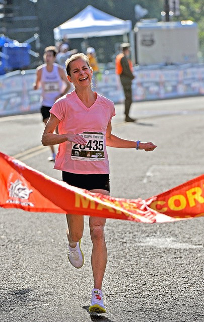 Woman running toward the finish line
