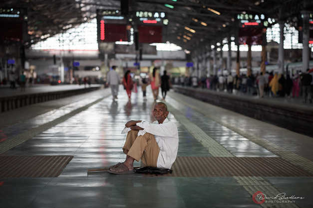 Seated Man in Train Station