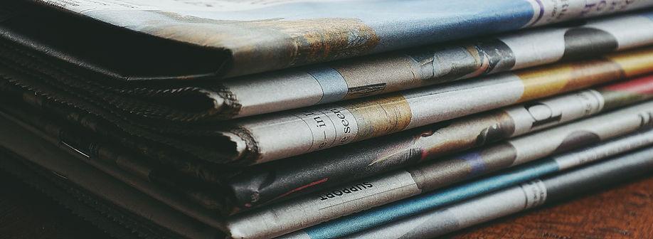 red-framed-eyeglasses-on-newspapers-3886