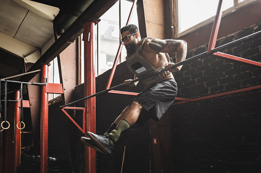 Man doing muscle up exercise. Strong spo