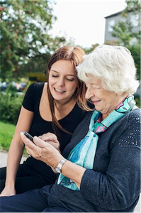 mHealth helping an older lady with her smartphone