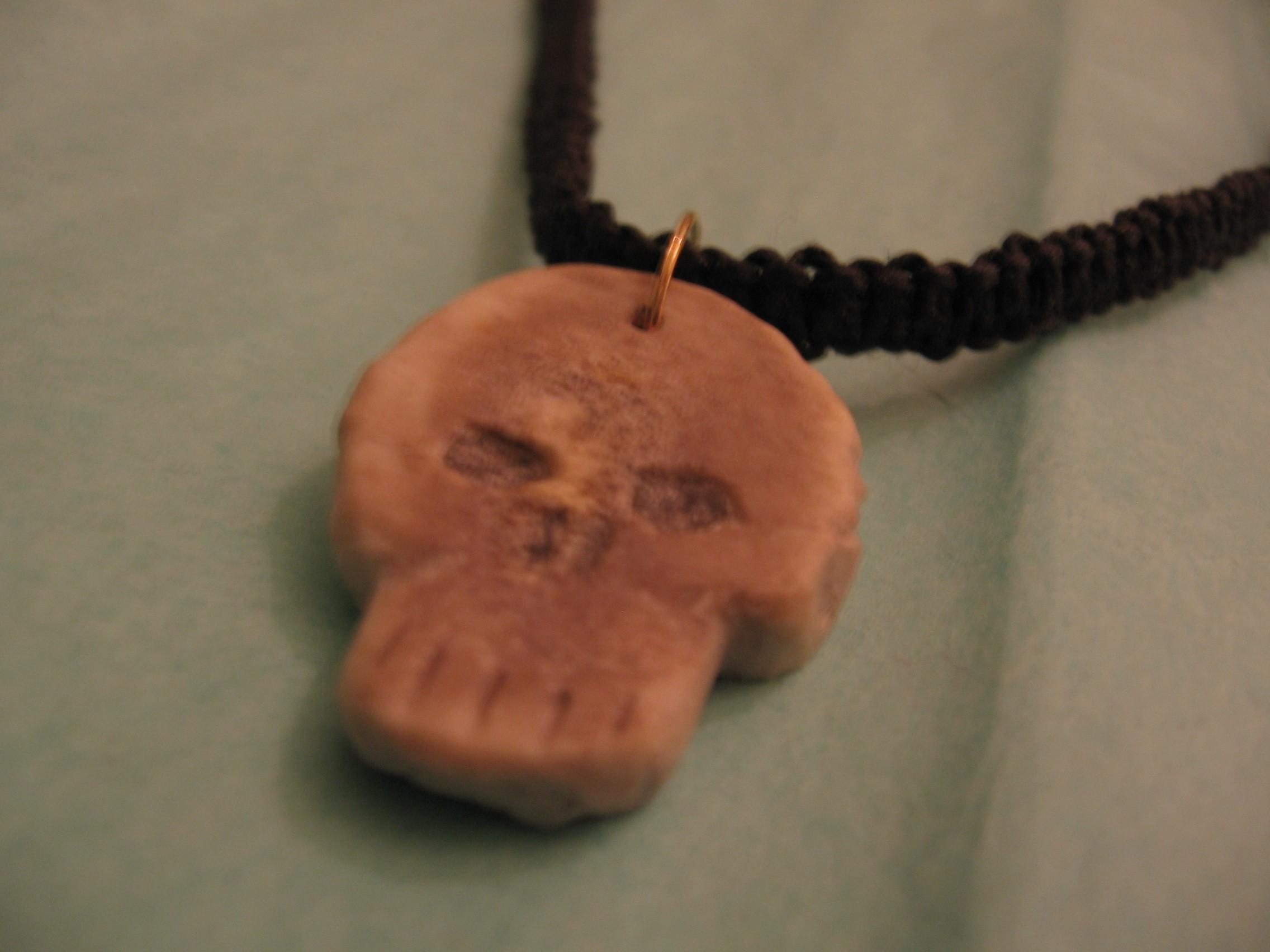 Carved Bone Skull Necklace