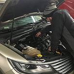 Brad working on a vehicle.jpg