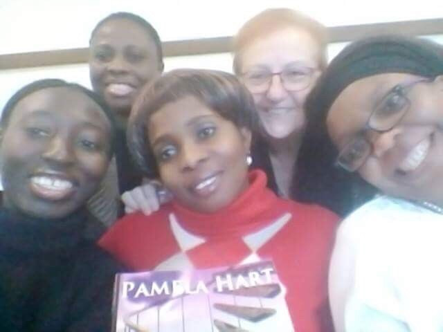 Sister Rita and the women, of African decent, walking through the healing process in Italy with MY book!