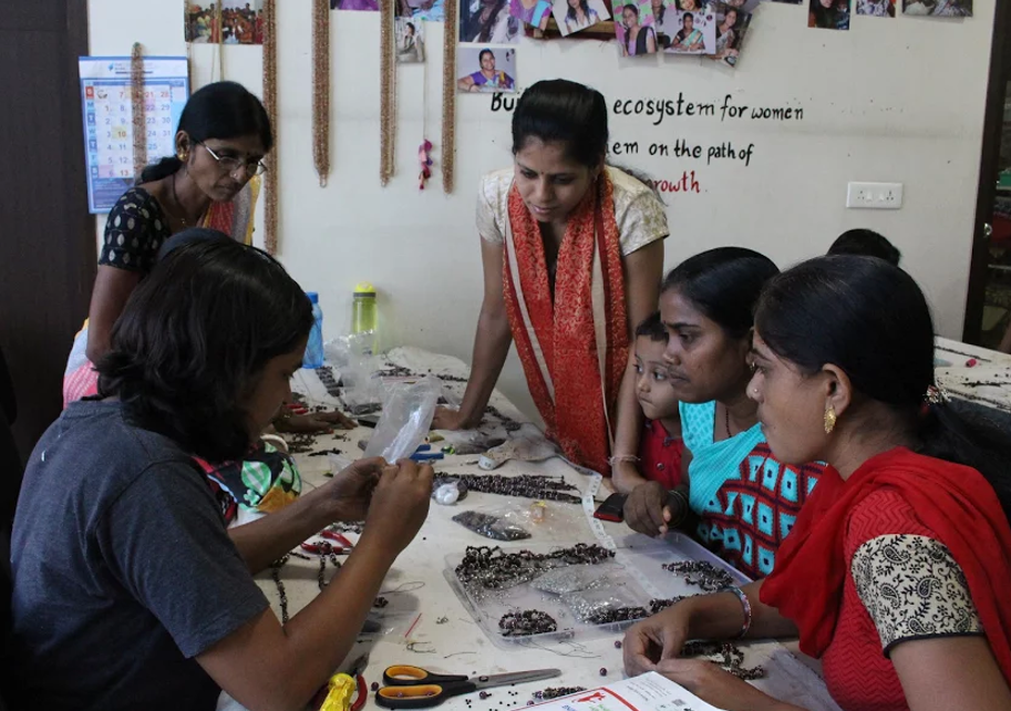 Abiras learning jewelry making.png