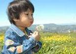 Boy blowing.jpg