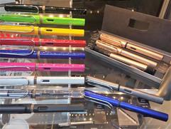 Fountain pens, ballpoint and roller ball pens