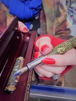 Sarah hand holding pen.jpg
