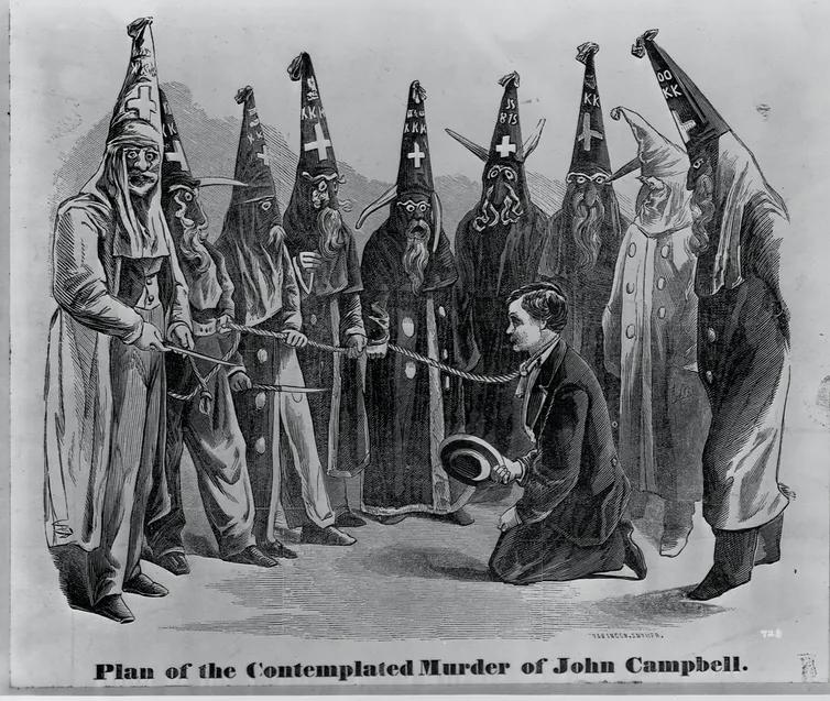 Ku Klux Klansmen Threatening John Campbell, Getty Imagess