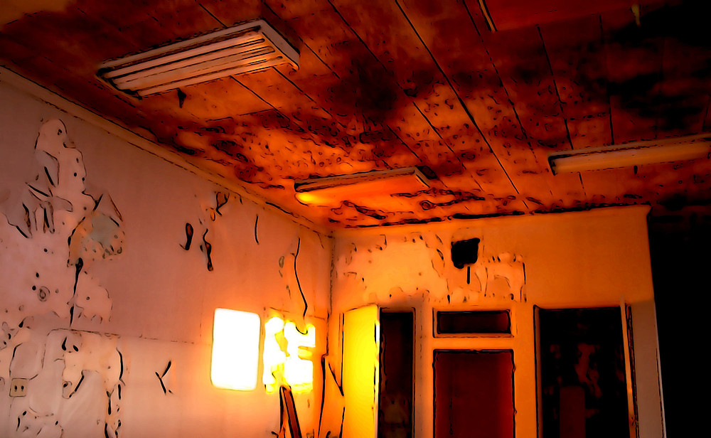Rosy golden sunrise glow inside the offices of the abandoned steel factory, the Opsal, in Vancouver, BC