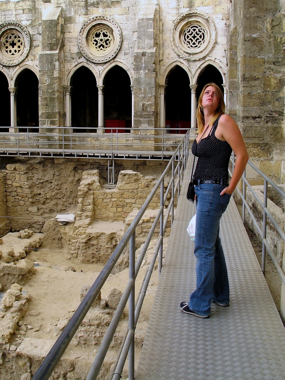 Lisa feeling the history inside the Sé Cathedral in Lisbon, Portugal.
