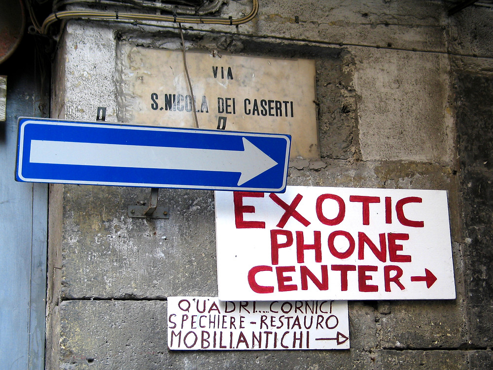 Naples, Italy - Side street signage, including Exotic Phone Center