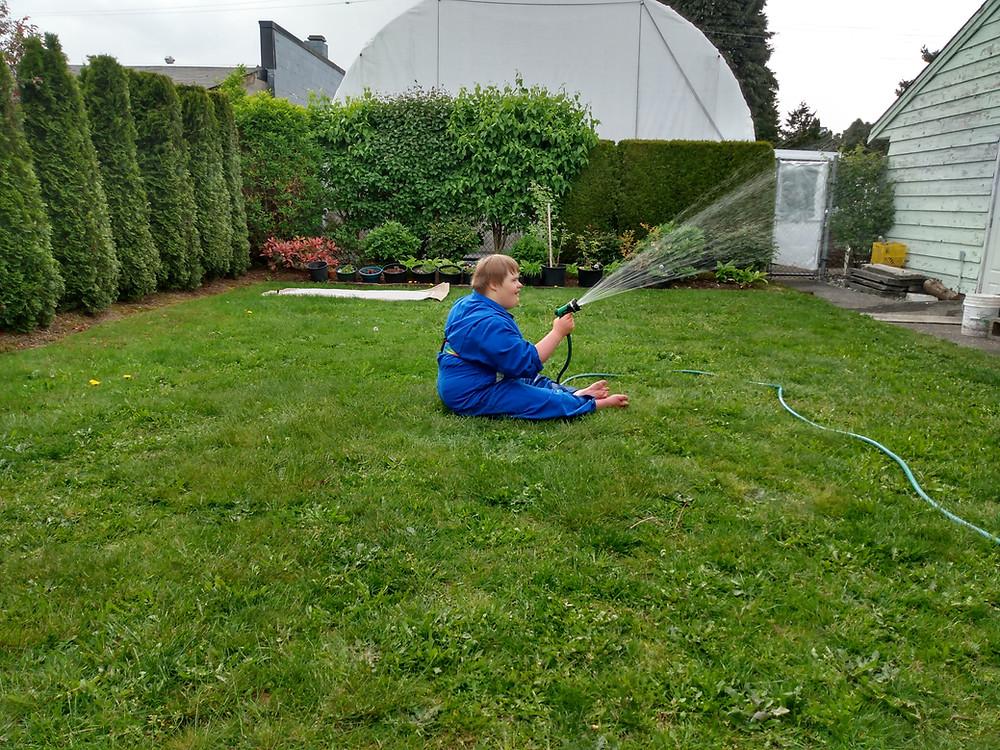 Rowan finds joy with a hose and a spray gun.