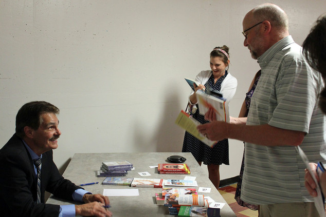 Dr Ray talking to book signers3.jpg